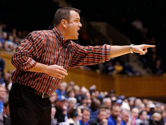 Louisville head coach Jeff Walz gives instructions to his team during the first half of an NCAA college basketball game against Duke Monday, Feb. 2, 2015 in Durham, N.C. (AP Photo/Ellen Ozier)
