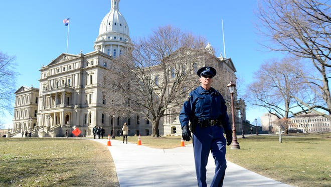 State Property Security Officer Steve Rains conducts his rounds around the Capitol Building on Tuesday.