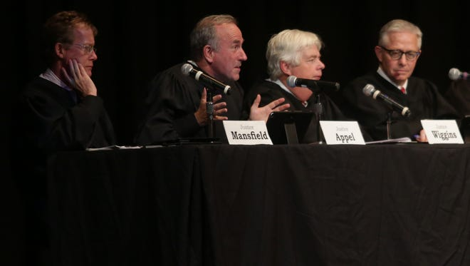 Iowa Supreme Court Justice Brent Appel (second from left) questions attorney Mitchell Nass as he presents Warren County's case during a session held at the Newton High School auditorium Oct. 14. Appel is flanked by Justice Edward Mansfield on the left and Justice David Wiggins and Chief Justice Mark Cady on the right.