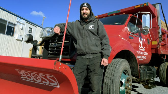 Shoffner Construction owner Brett Shoffner stands with a newly acquired truck and plow at his Felton business Tuesday, Jan. 19, 2016. Shoffner began his snow and ice management service last year and purchased this second truck last summer.