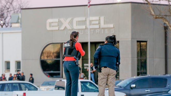 Police guard the front door of Excel Industries in Hesston, Kan., Thursday, Feb. 25, 2016.