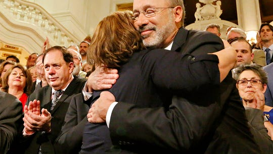 Lolly Bentch, of Harrisburg, hugs Gov. Tom Wolf before