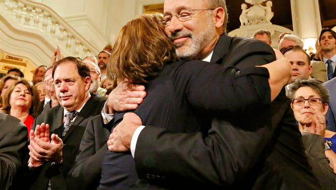 Lolly Bentch, of Harrisburg, hugs Gov. Tom Wolf before he signs the medical cannabis bill into law in the rotunda of the Capitol in Harrisburg, Sunday, April 17, 2016. Dawn J. Sagert photo
