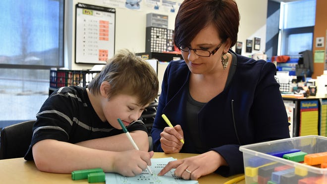 Special ed teacher Jodee Prudente works with her student Aden Medley at Depoali Middle School.