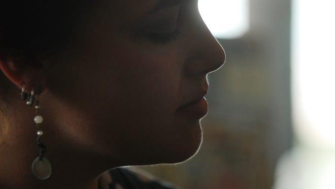 Jillian Johnson closes her eyes as she plays a song on the ukulele at Coffee Break in Breaux Bridge.