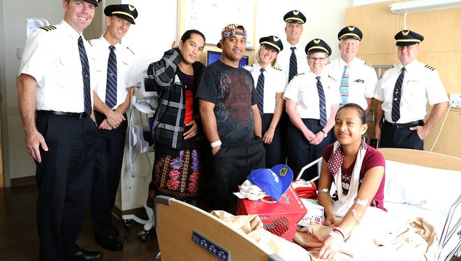 """Pilots for Kids""""with 13-year-old Machita William, her mother and brother."""