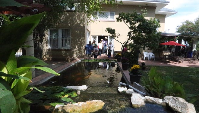 A coy pond and fountain outside the De Leon Home at 700 W. Yandell.
