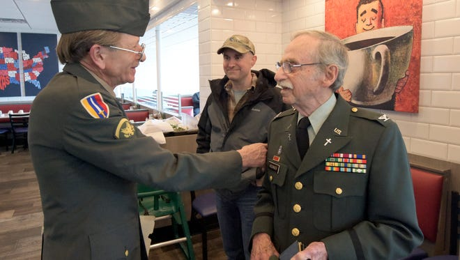 Phil Kissinger and John Bennett, left, reunite for the first time in nearly 50 years for a lunch at Round the Clock Diner Thursday, March 8, 2018. Kissinger's nephew Sean Frey, center, accompanied his uncle. Kissinger was a chaplain during the Vietnam war, and he wrote a grievance letter to Bennett's family when Bennett was believed to be dead after he was struck by lightning. Bennett awoke in a body bag and had to cut himself out of it. Bill Kalina photo