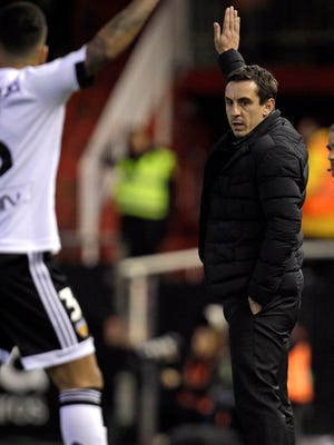 Valencia's head coach Gary Neville gestures during the second leg of a semifinal match in the Copa del Rey against Barcelona.