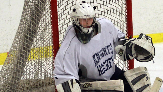 Pope John Paul II goalie Garrett Bennett covers up the right side of the net during a game earlier this season. Bennett was one of eight local players named to the GNASH All-Star Game.