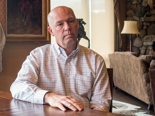 FILE--In this June 20, 2017, file photo, Montana Rep.-elect Greg Gianforte responds to questions at his home in Bozeman, Mont., about an election-eve confrontation with a reporter. The head of the Montana Democratic Party on Thursday, May 24, 2018, asked for a congressional ethics investigation into whether Gianforte lied to the police and the public when he assaulted a reporter last year. (AP Photo/Bobby Caina Calvan, file)