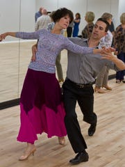 Luciano Catelli, owner of Shore DanceSport, a dance studio in Brick,practices a waltz with Doreen Bender of Brielle.