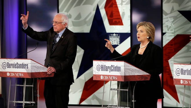 Hillary Rodham Clinton, right, makes a point as Bernie Sanders listens during a Democratic presidential primary debate, Saturday, Nov. 14, 2015, in Des Moines, Iowa.