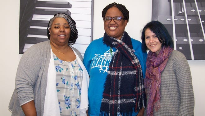 Sunnah Bilal Shakir (center) poses with Jennifer Lebowitz (right), a behaviorist at Community Access Unlimited, and Shantena Fleming, employment specialist/job developer.
