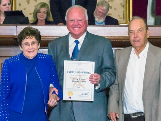 Agriculture Commissioner Sid Miller, center, recognizes