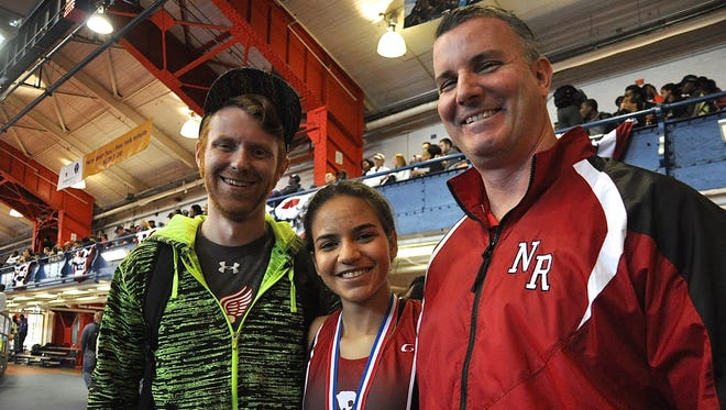 North Rockland coaches Kyle Murphy, left, and Brian Diglio, right, with senior Maria Garcia after she finished third in the New Balance Nationals 2016 mile racewalk.