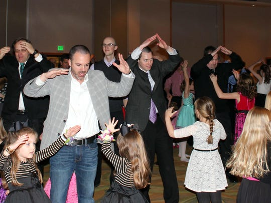 Fathers and daughters enjoy a dance during the annual Anderson Park District Father/Daughter Dance.
