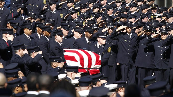 Members of the Cincinnati Fire Department carry the casket of Daryl Gordon after funeral services on Wednesday.