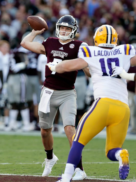 Mississippi State quarterback Nick Fitzgerald (7) attempts a pass as LSU defensive end Christian LaCouture (18) defends during the first half of their NCAA college football game against in Starkville, Miss., Saturday, Sept. 16, 2017. (AP Photo/Rogelio V. Solis)
