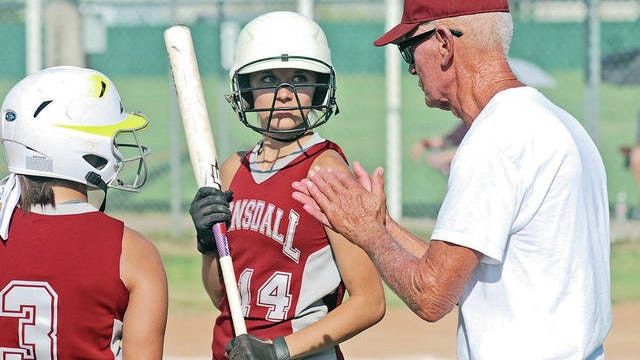 Joe Gilbert encourages members of his 2013 Barnsdall High School slowpitch team, which went on to capture the state championship. Mike Tupa/Examiner-Enterprise file