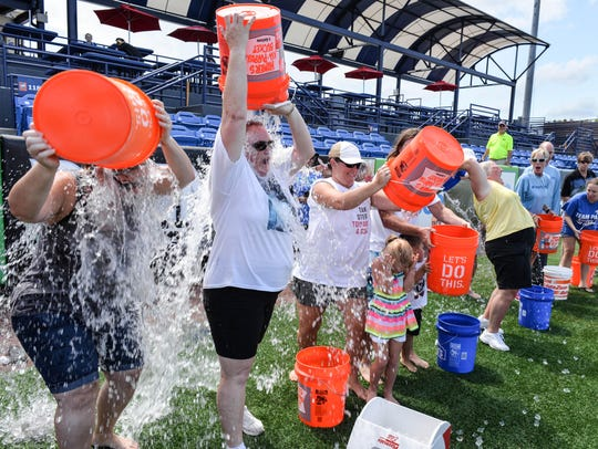 Cindy Almeida (wearing sunglasses) soaks herself during the ice bucket challenge in 2017. The third annual ALS Awareness Day and Ice Bucket Challenge is 11 a.m.-3 p.m. Sunday at First Data Field in Port St. Lucie.