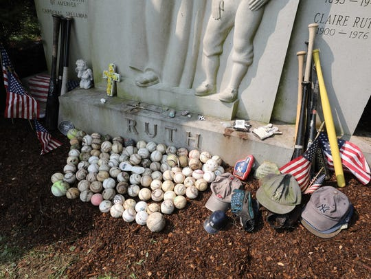 Items were neatly rearranged by the gravediggers at the grave of Babe Ruth at the Gate of Heaven cemetery in Hawthorne, on the 70th anniversary of his death Aug. 16, 2018.
