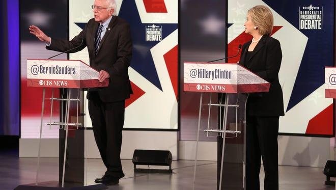 Vermont U.S. Sen. Bernie Sanders speaks as former Secretary of State Hillary Clinton looks on during the Democratic presidential debate Saturday, Nov. 14, 2015, at Drake University in Des Moines, Iowa.