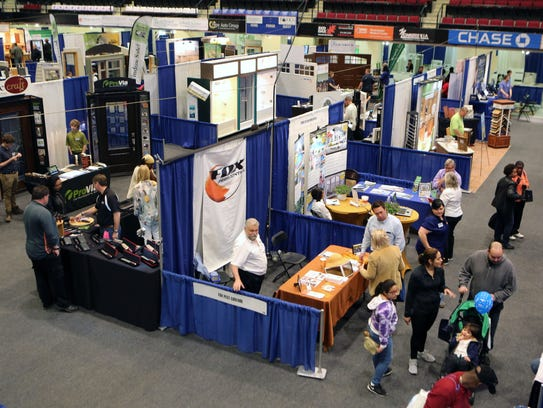 Attendees browse the home improvement booths at the