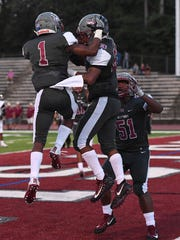 Westside's Paul Johnson (23), center, celebrates with