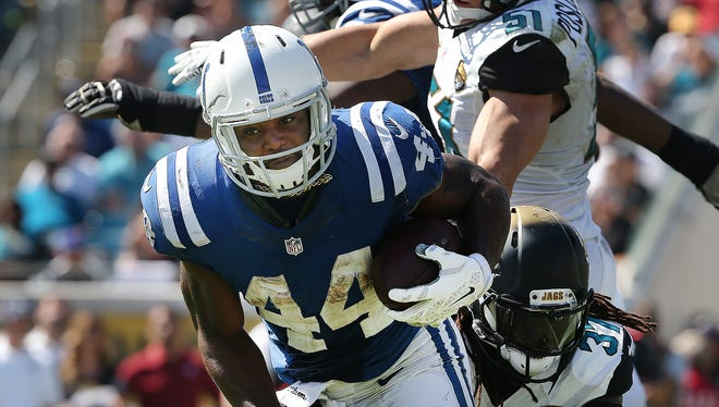 Indianapolis Colts Ahmad Bradshaw runs by Jacksonville Jaguars Johnathan Cyprien in the second half. The Indianapolis Colts defeated the Jacksonville Jaguars 44-17 Sunday, September 21, 2014, afternoon at EverBank Field in Jacksonville FL.
