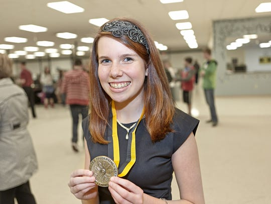 Peyton Medick poses with her Prudential Spirit of Community