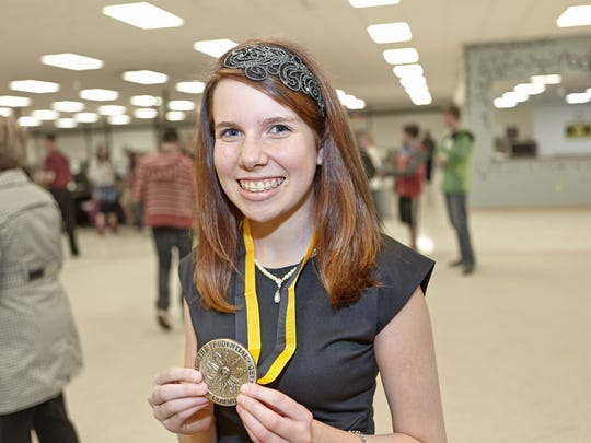 Peyton Medick poses with her Prudential Spirit of Community state honoree award at Idea Charter School in Weston in this 2013 file photo.