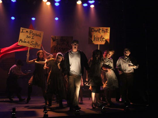 "A performance of ""Urinetown."""