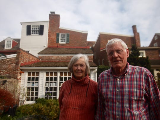 Sandy and Binney Beale stand outside their historic home in Old New Castle. The Beales say they Pokemon players are wrecking the city's historic vibe.