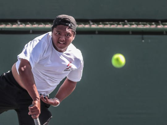 Palm Springs' Michael Cabacungan won three matches without dropping a game.