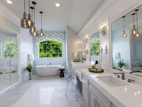 Mixing tile sizes, finishes and textures creates an