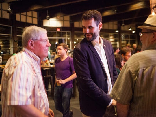 Zach Wahls is greeted by outgoing state Sen. Bob Dvorsky