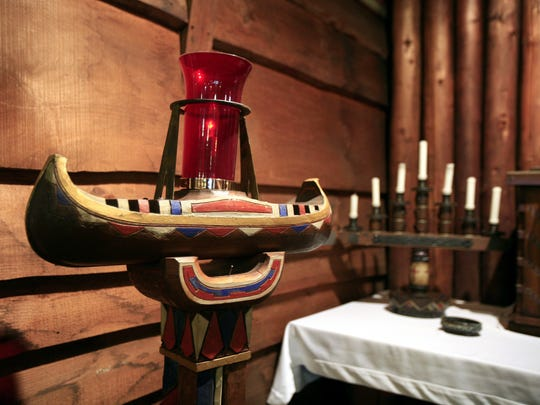 A two foot long decorated canoe holds the altar light at the Church of the North American Martyrs in Putnam Valley.