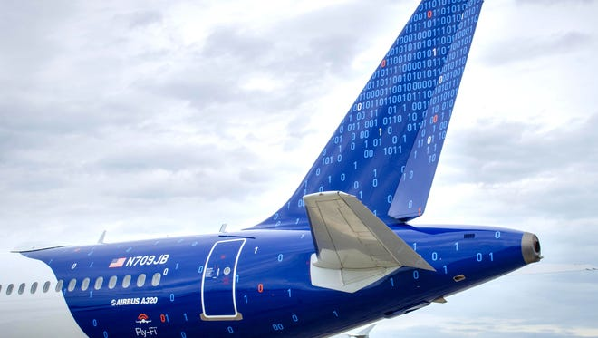 An undated photo of JetBlue's binary code-themed Airbus A320.