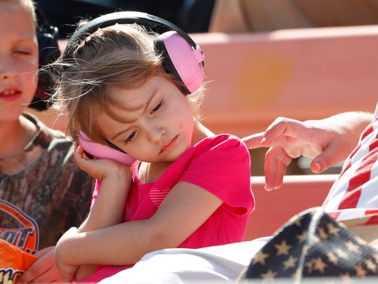 A young fan rests her head at ISM Raceway during the Ticket Guardian 500 on March 11, 2018 in Avondale, Ariz.