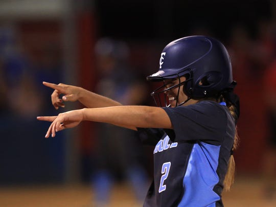 Carroll's Lisa Sosa celebrates after getting a single and batting a runner in during the ninth inning to go ahead of Gregory-Portland at the Gregory-Portland High School softball field on March 24, 2017.