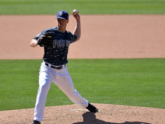 Padres left-hander Clayton Richard tossed a complete game against the Diamondbacks on Sunday.
