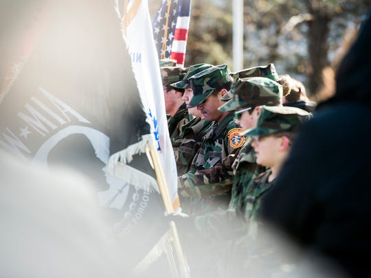 Members of the Hanover Area Young Marines observe a moment of silence during the Wreaths Across America ceremony, Saturday, Dec. 16, 2017. This was the fifth year for Wreaths Across America at Mt. Olivet Cemetery, where over 1,700 veterans are honored.