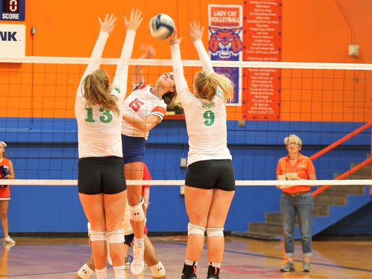 San Angelo Central High School's Trinity Southall (15)  looks to drive a shot between Wall's Kaitlyn Stephens (13) and Rylee Braden during the Nita Vannoy Memorial Volleyball Tournament at Babe Didrikson Gym on Friday, Aug. 17, 2018. Central swept all three of its pool play matches on Friday to advance to the Gold Division.
