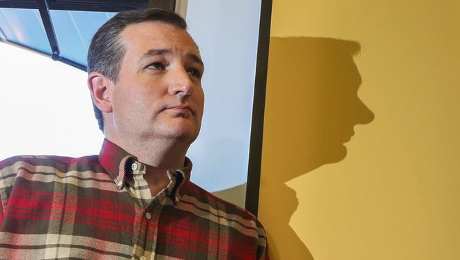 Sen. Ted Cruz waits to be introduced before speaking at the Crossroads Shooting Sports gun shop on Friday, Dec. 4, 2015, in Johnston, Iowa.