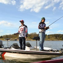 Erik Quanrud, left and Dan Carlson of St. Cloud State University's Husky Bass Fishing Club took time out for a photo shoot in early April while they prefished Missouri's Table Rock Lake before a tournament.