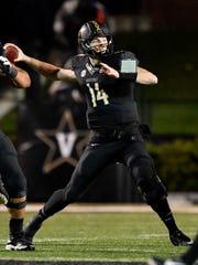 Vanderbilt quarterback Kyle Shurmur (14) passes against Missouri during the first half at Vanderbilt Stadium in Nashville, Tenn., Saturday, Nov. 18, 2017.