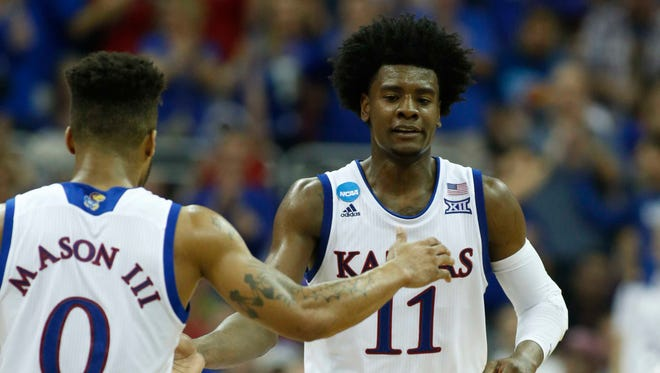 Kansas Jayhawks guard Josh Jackson (11) reacts with guard Frank Mason III (0) during the second half against the Purdue Boilermakers in the semifinals of the midwest Regional of the 2017 NCAA tournament at Sprint Center.