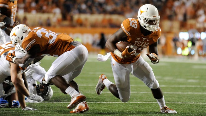 Texas tailback D'Onta Foreman (33) cuts through the Rice defense in a victory Sept. 12.