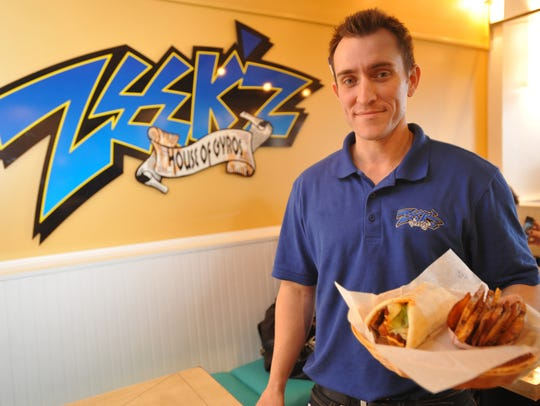 Sean Alexander, owner of Zeek'z House of Gyros, holds